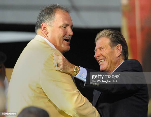 Former Washington Redskin and NFL Hall of Fame inductee Russ Grimm left and his former line coach Joe Bugel right embrace aftr the the ceremony at...