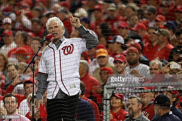 Former Washington Redskins player and Pro Football Hall of Fame member John Riggins yells 'Play Ball' prior to game five of the National League...