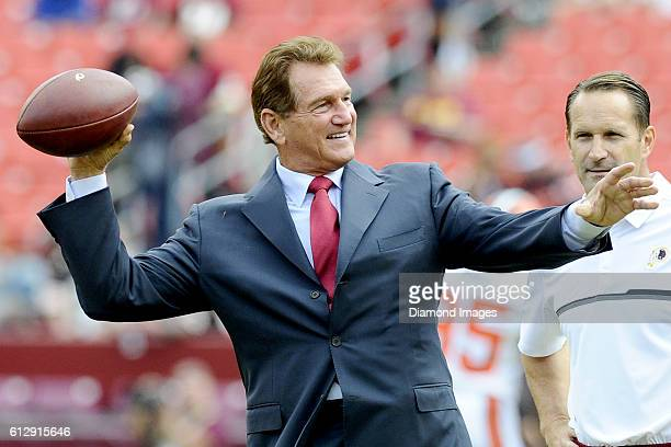 Former Washington Redskins quarterback Joe Theismann throws a pass prior to a game against the Cleveland Browns on October 2, 2016 at FedEx Field in...