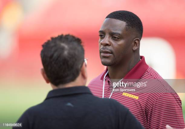 Former Washington Redskins running back Clinton Portis looks on from the sidelines prior to the NFL preseason game between the Cincinnati Bengals and...