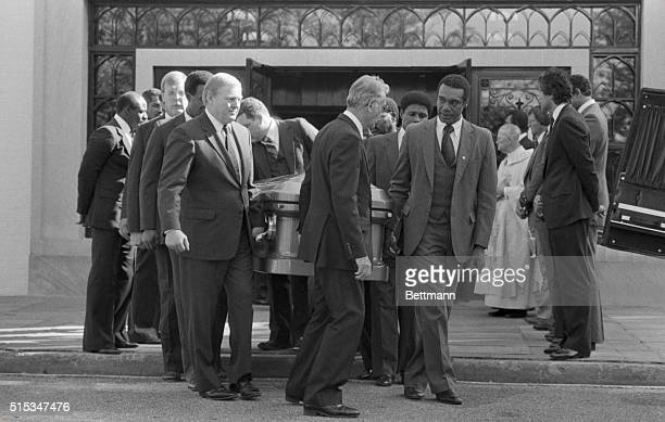 Former Washington Redskins Sonny Jurgenson and Roy Jefferson assisted by a funeral home attendant serve as lead pallbearers as they carry the casket...