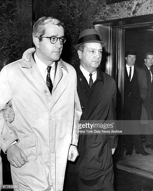 Former Water Commissioner James Marcus is escorted from FBI headquarters in New York by an unidentified FBI agents Marcus who recently resigned as...
