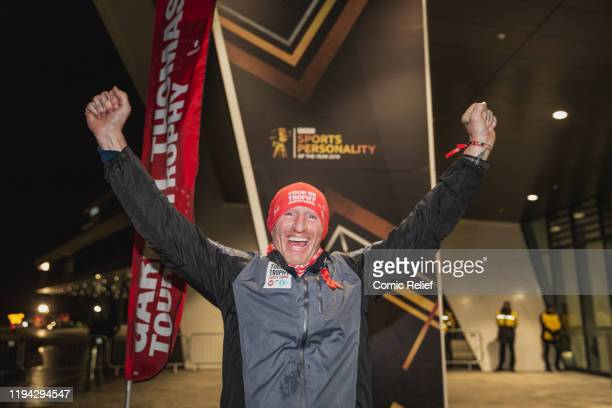 Former Welsh, and British and Irish Lions, rugby captain Gareth Thomas celebrates as he completes Day 7 of the Tour De Trophy challenge in aid of...
