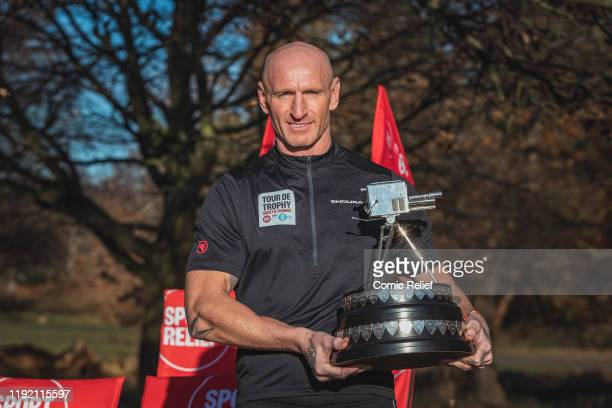 Former Welsh and British Lions rugby captain, Gareth Thomas, poses with the Quattrocycle and the BBC Sport Personality of the Year trophy in Richmond...