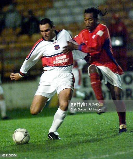 Former Welsh captain Vinnie Jones in action for Carlisle United against Shelbourne FC's guest player James Emuagwuna during the friendly game at...