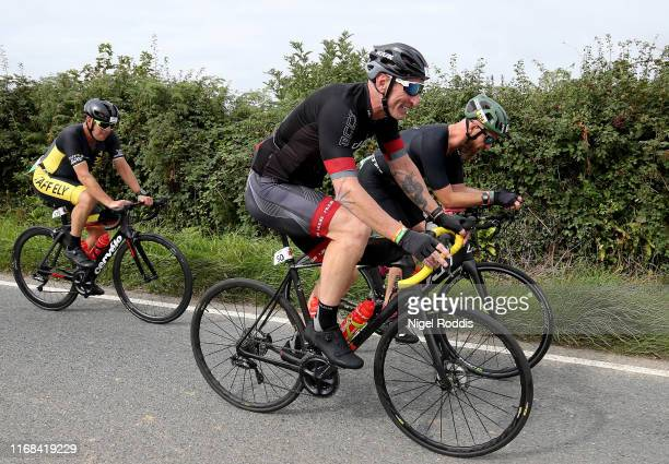 Former Welsh rugby International captain Gareth Thomas competes during Ironman Wales on September 15, 2019 in Tenby, Wales.