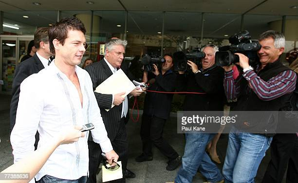 Former West Coast Eagles AFL player Ben Cousins and his lawyer Shane Brennan leave the Perth Magistrates Court after facing drug possession charges...