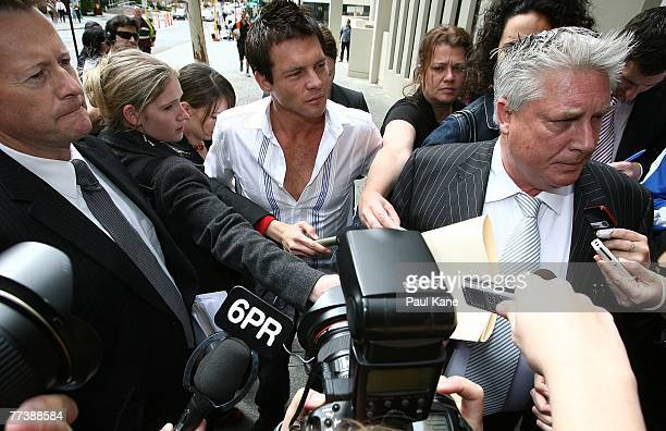 Former West Coast Eagles AFL player Ben Cousins looks on as lawyer Shane Brennan speaks with media attending the Perth Magistrates Court after facing...