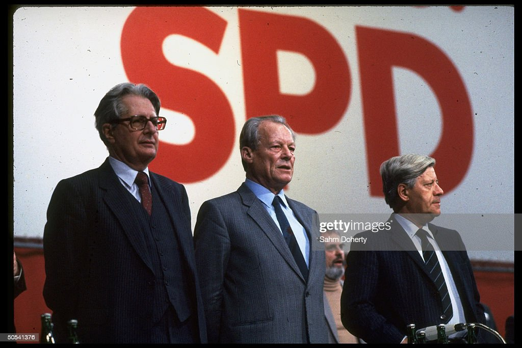 Former West German Chancellors Helmut Schmidt and Willy Brandt standing with Chancellor candidate Hans Jochen Vogel at Social Democratic Party (SPD) congress.