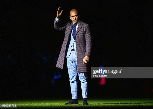 Former West Ham United player Paolo Di Canio salutes the crowd as part of the after match presentations following the Barclays Premier League match...