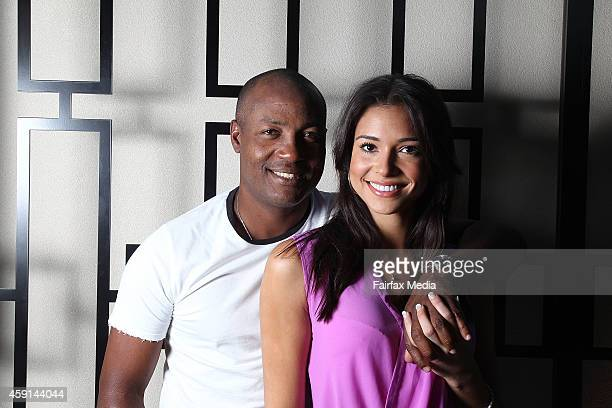 Former West Indian cricket player Brian Lara poses for a portrait with his partner, Jamey Bowers on November 17, 2014 in Sydney, Australia. Lara is...