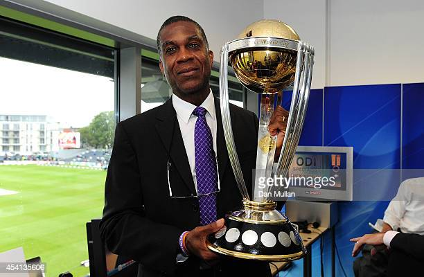 Former West Indian Cricketer Michael Holding poses with the ICC Cricket World Cup Trophy during the England v India One Day International at The...