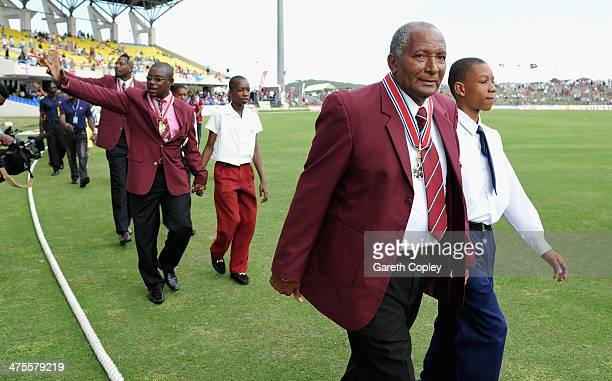 Former West Indian cricketers Andy Roberts, Richie Richardson and Curtly Ambrose are paraded round the field after being awarded knighthoods during...