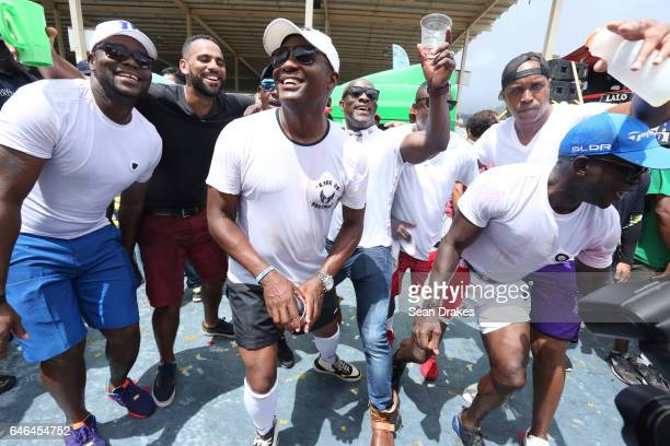 Former West Indies Cricket captain Brian Lara poses with friends in Tribe Bliss mas band at the Queen's Park Savannah during Trinidad Carnival on...