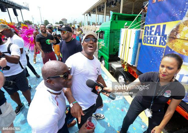 Former West Indies Cricket captain Brian Lara sings to a news reporter covering the Parade of Bands in the Queen's Park Savannah during Trinidad...