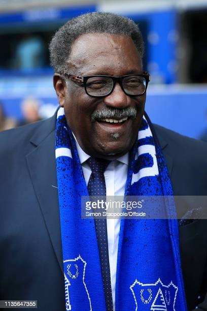 Former West Indies cricketer Clive Lloyd laughs as he meets former Arsenal player Ian Wright during the Premier League match between Everton and...
