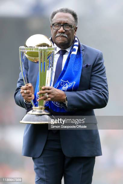 Former West Indies cricketer Clive Lloyd parades the ICC Cricket World Cup trophy before the Premier League match between Everton and Arsenal at...