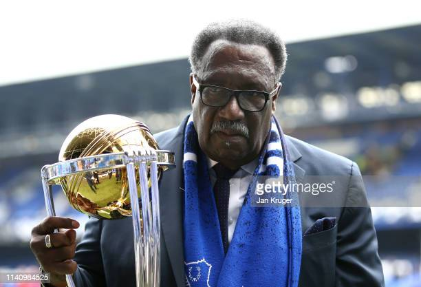 Former West Indies Cricketer, Clive Lloyd poses with the Cricket World Cup Trophy prior to the Premier League match between Everton FC and Arsenal FC...