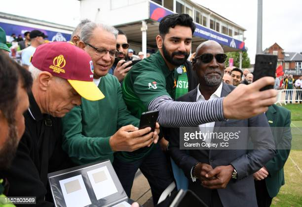 Former West Indies Cricketer Sir Vivian Richards poses for a photo with fans during the Group Stage match of the ICC Cricket World Cup 2019 between...