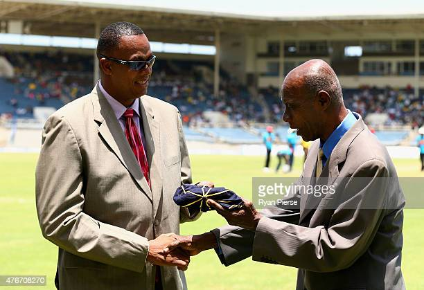 Former West Indies cricketer Wes Hall is inducted into the ICC Hall of Fame by Courtney Walsh during day one of the Second Test match between...