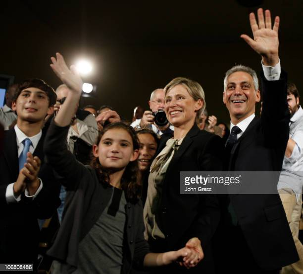 Former White House chief of staff Rahm Emanuel, his wife Amy Rule, and their children Leah and Zach wave to the crowd after Emanuel officially...