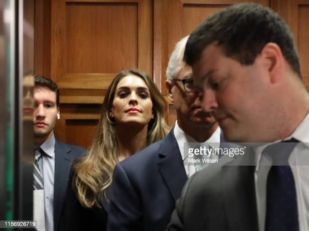 Former White House communications director Hope Hicks stands in an elevator before arriving at a closed-door interview with the House Judiciary...