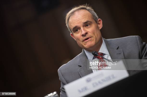 """Former White House cybersecurity coordinator Michael Daniel testifies before the Senate Intelligence Committee during a hearing on """"Policy Response..."""
