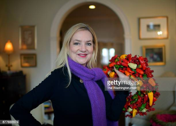 Former White House Floral Designer Laura Dowling hold a wreath that she constructed out of peppers for the Christmas issue photographed in Alexandria...