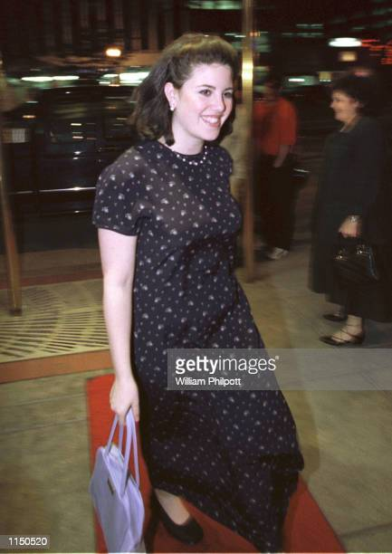 Former White House intern Monica Lewinsky, implicated in a sex scandal with President Clinton enters a restaurant April 2, 1998 in Washington, DC.