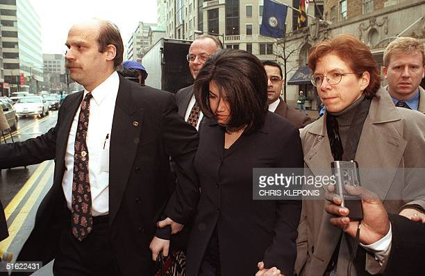 Former White House intern Monica Lewinsky is escorted across Connecticut Avenue 02 February in Washington, DC, enroute to her attorneys office....