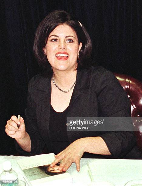 Former White House intern Monica Lewinsky looks up as she signs her book, 'Monica's story', during a signing 23 April, 1999 at a book store in Fort...
