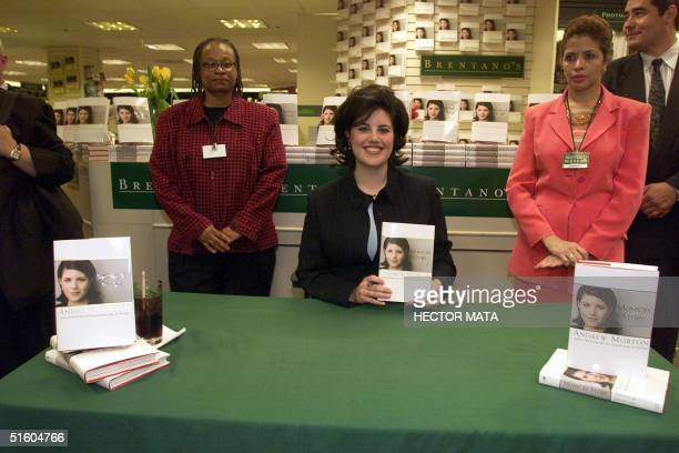 Former White House intern Monica Lewinsky poses with a copy of her book in a bookstore in Los Angeles, 22 March 1999. Lewinsky cut short a book tour...