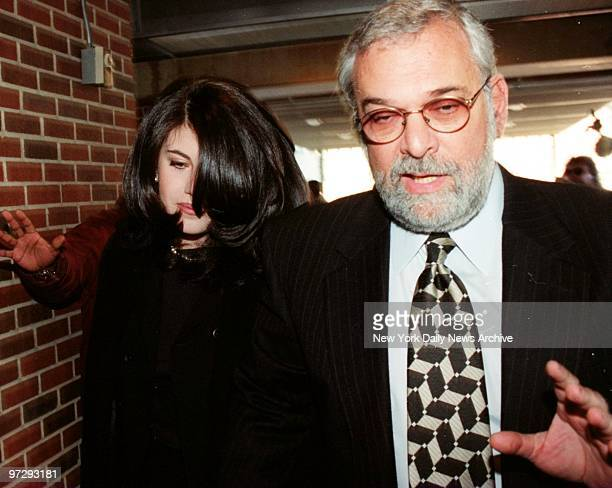 Former White House intern Monica Lewinsky walks with her lawyer William Ginsberg
