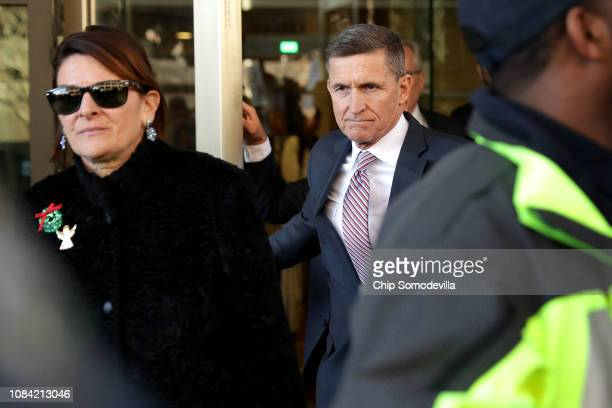 Former White House National Security Advisor Michael Flynn and his wife Lori Andrade leave the Prettyman Federal Courthouse following a sentencing...