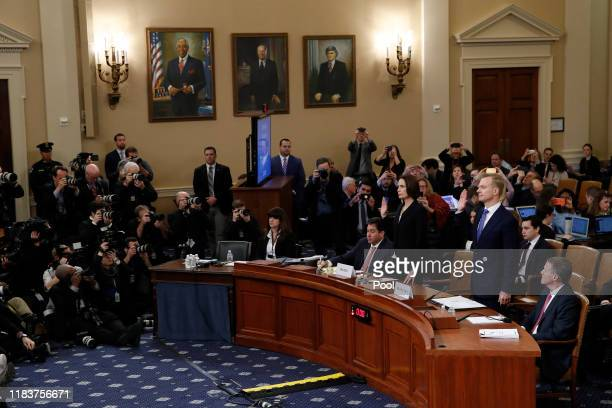 Former White House national security aide Fiona Hill and David Holmes a US diplomat in Ukraine are sworn in before testifying before the House...