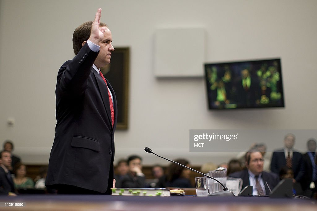 Former White House Press Secretary Scott McClellan's (R) attorney Michael Tigar (L) attempts to speak on his behalf before testimony about his comments about the Bush administration's run-up to the Iraq war from his book before the House Judiciary Committee on Capitol Hill in Washington, June 20, 2008.