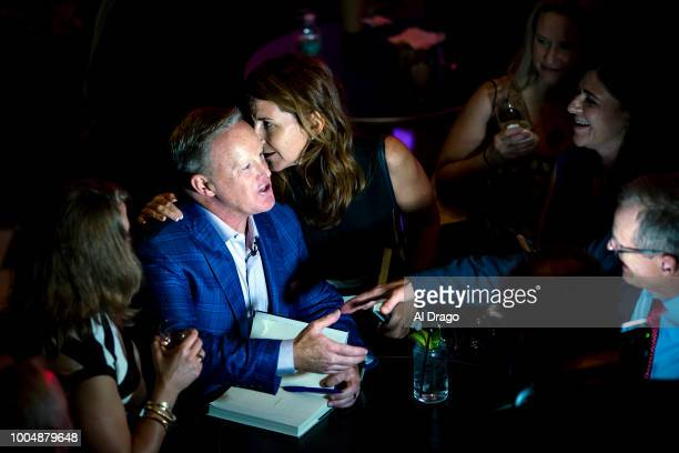 Former White House Press Secretary Sean Spicer greets guests as he signs a copy of his new book The Briefing Politics The Press and The President at...