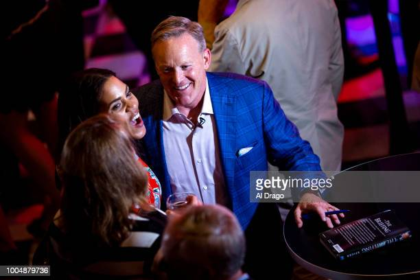 Former White House Press Secretary Sean Spicer greets guests as he signs a copy of his new book 'The Briefing Politics The Press and The President'...