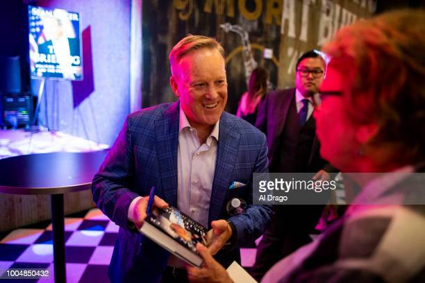 Former White House Press Secretary Sean Spicer signs a copy of his new book The Briefing Politics The Press and The President at a launch party at...