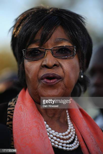 Former wife of Nelson Mandela Winnie MadikizelaMandela speaks to the press outside Nelson Mandela House in Soweto on June 28 2013 in Johannesberg...