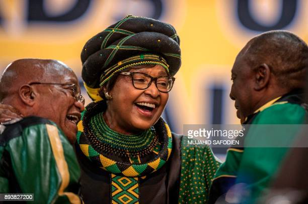 Former wife of the late South African President Nelson Mandela antiapartheid campaigner Winnie Mandela hugs South African President Jacob Zuma and...