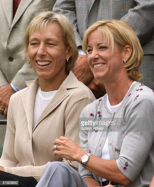 Former Wimbledon champions Martina Navratilov and Chris Evert both of the US share a light moment as they along with fellow Wimbledon winners and...
