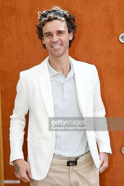 Former winner of RG, Gustavo Kuerten attends Roland Garros Tennis French Open 2013 - Day 2 on May 27, 2013 in Paris, France.