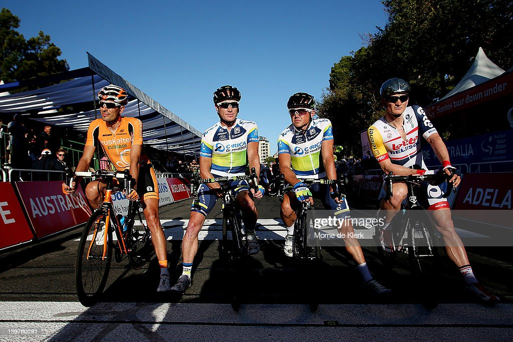 Former winners of the Tour Down Under that are riding in the 2013 race l-r, Mikel Astarloza of Spain and team Euskatel-Euskadi, Stuart O'Grady and Simon Gerrans of Australia and team Orica Greenedge and Andre Greipel of Germany and team Lotto Belisol lines up at the starting line before the People's Choice Classic race of the Tour Down Under on January 20, 2013 in Adelaide, Australia.