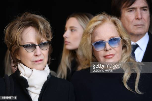 Former wives of late French singer Johnny Hallyday French actress Nathalie Baye French singer Sylvie Vartan leave the La Madeleine Church after the...