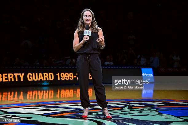 Former WNBA player Becky Hammon speaks to the crowd during her New York Liberty Ring of Fame induction ceremony on August 2 2015 in New York New York...