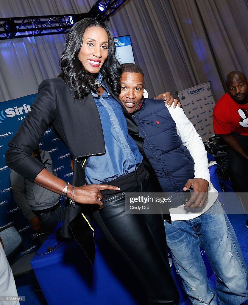 Former WNBA player Lisa Leslie and actor/recording artist Jamie Foxx attend SiriusXM at Super Bowl XLIX Radio Row at the Phoenix Convention Center on January 30, 2015 in Phoenix, Arizona.