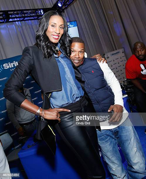 Former WNBA player Lisa Leslie and actor/recording artist Jamie Foxx attend SiriusXM at Super Bowl XLIX Radio Row at the Phoenix Convention Center on...