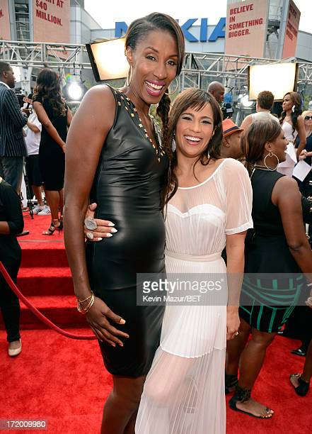 Former WNBA player Lisa Leslie and actress Paula Patton attend the Ford Red Carpet at the 2013 BET Awards at Nokia Theatre LA Live on June 30 2013 in...