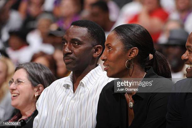 Former WNBA player Lisa Leslie and her husband Michael Lockwood attend a game between the Seattle Storm and the Los Angeles Sparks at Staples Center...